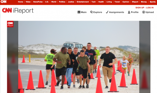 Marines help a young boy finish a triathlon